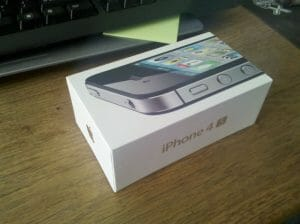 Photo of an iPhone 4S in its box